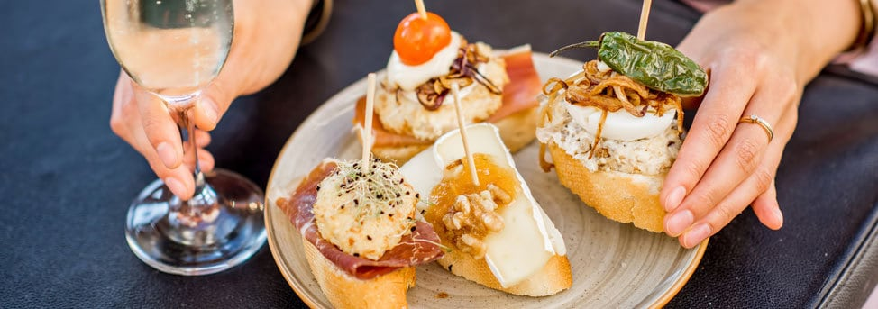 wine and canapes at poble sec in Barcelona
