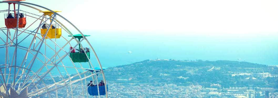 tibidabo with ferris wheel looking at amazing view of land and sea